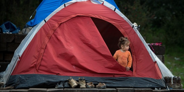 A girl stands inside a tent at a makeshift camp for migrants and refugees at the Greek-Macedonian border near the village of Idomeni on March 25, 2016. The UN human rights chief voiced alarm over an EU-Turkey deal to slow migrant arrivals to Europe, saying it had legal flaws and contradictions that could have global repercussions. / AFP / ANDREJ ISAKOVIC (Photo credit should read ANDREJ ISAKOVIC/AFP/Getty Images)